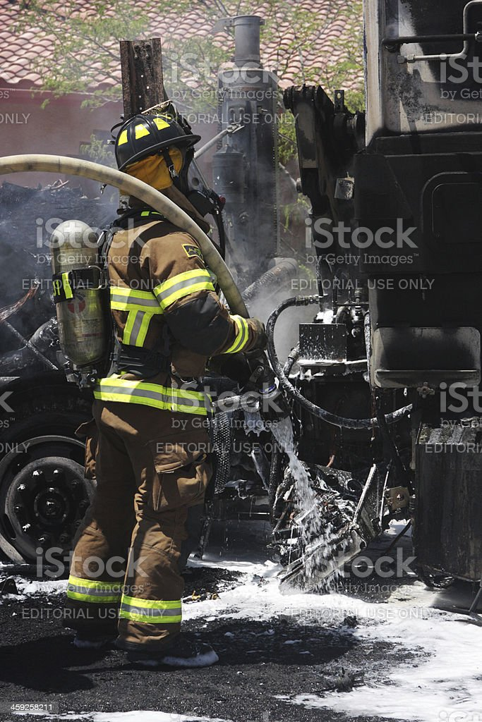 Firefighters Extinguish Fire Burnt Truck royalty-free stock photo