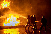 istock Firefighters extinguishing an industrial fire 1266019262