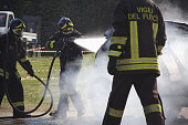 San Gillio, Italy - June 27, 2015: Demonstration switching off a car in flames by the Italian firefighters volunteers. Demonstration held in June 2015 in the province of Turin in Piedmont (Italy)