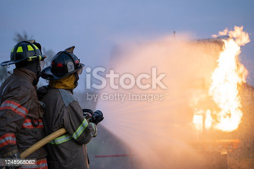 Firefighters fight against the raging fire from the fuel tank.