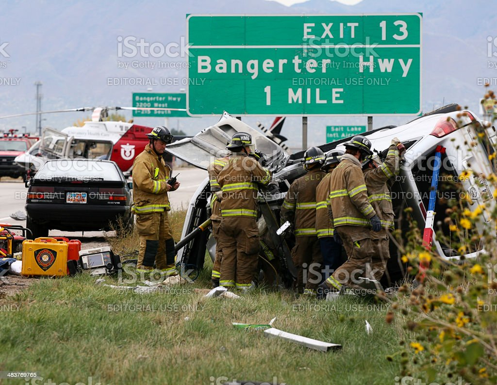 Firefighters Freeing Passenger from Wrecked Vehicle stock photo