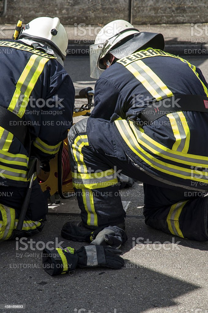 Firefighters from the fire department Langenau in action stock photo