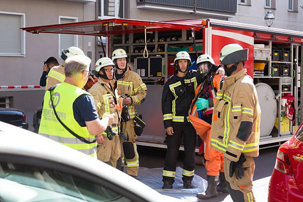 firefighters getting ready to intervene on chemical accident location. - feuerwehrmann deutsch stock-fotos und bilder