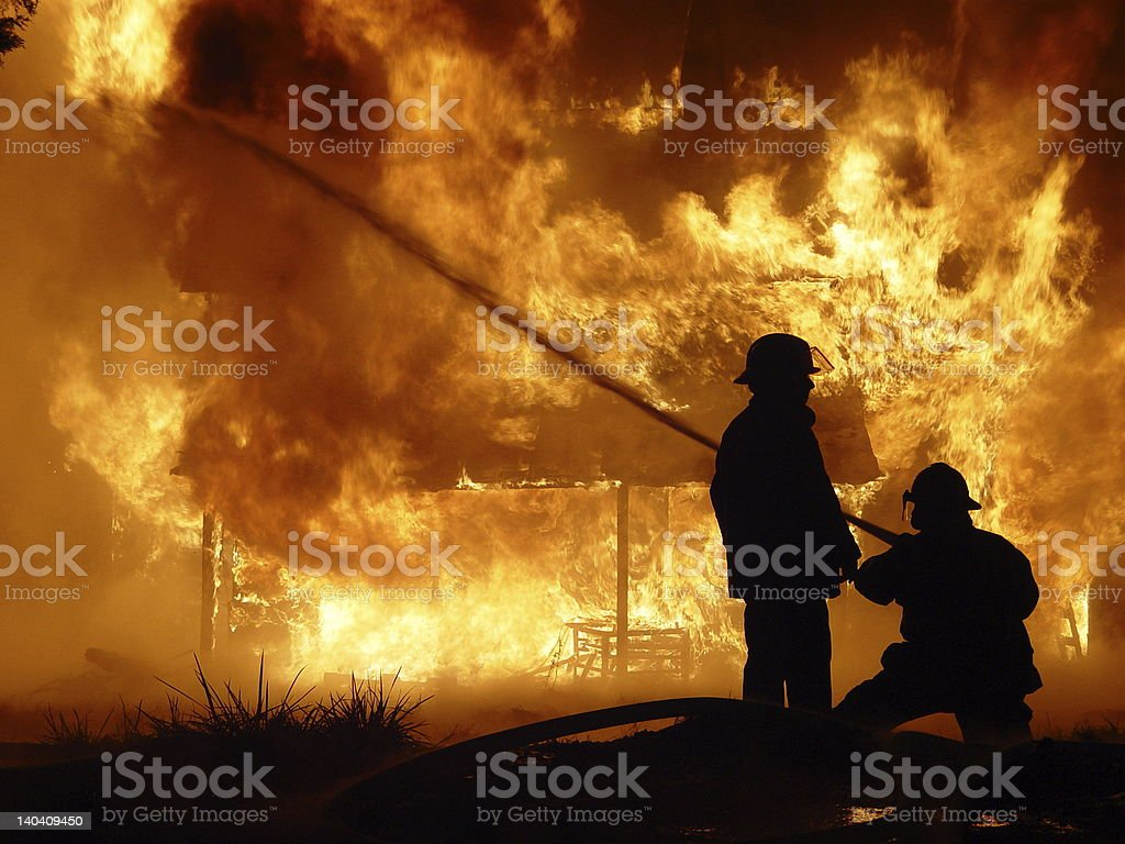 firefighters hose down house - Royalty-free Emergency Equipment Stock Photo