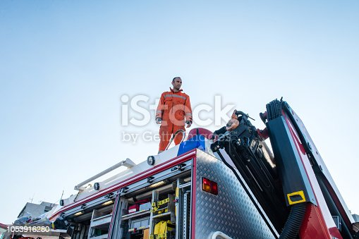 Firefighters in a rescue operation; all logos removed. Slovenia, Europe. Nikon.