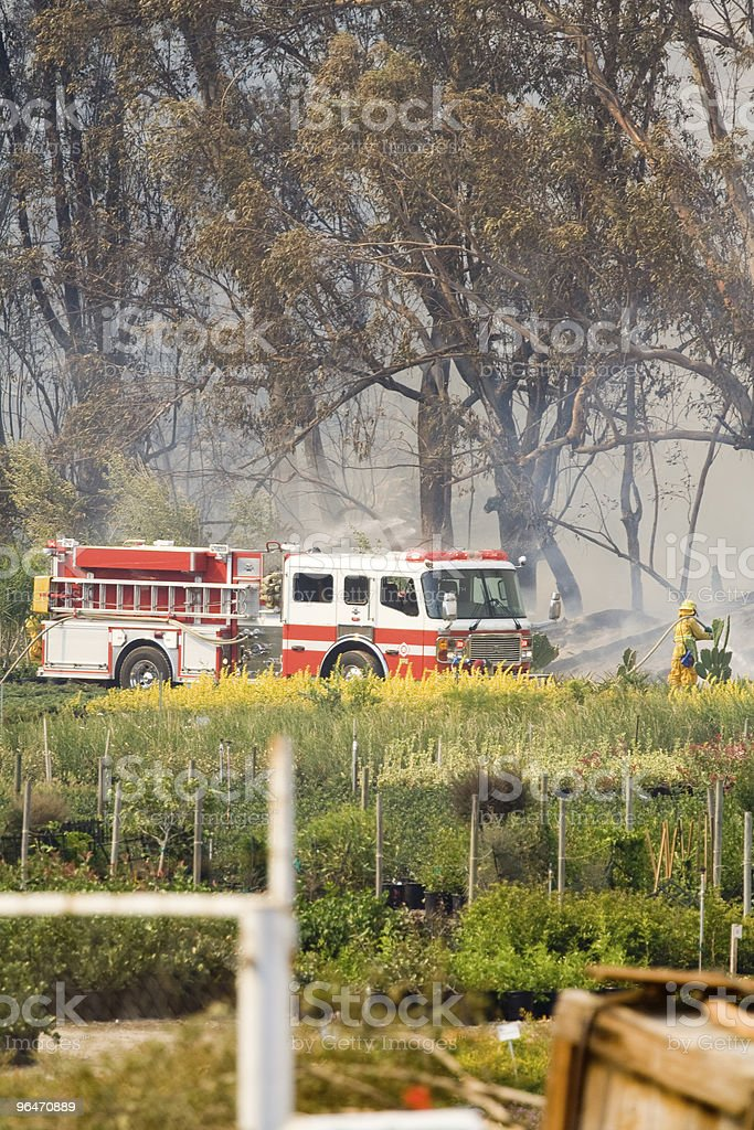Firefighters Mopping Up royalty-free stock photo
