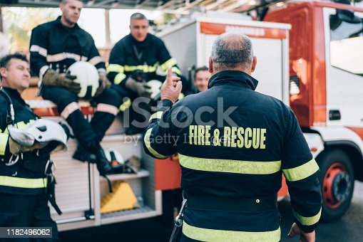 istock Firefighters on meeting before work 1182496062