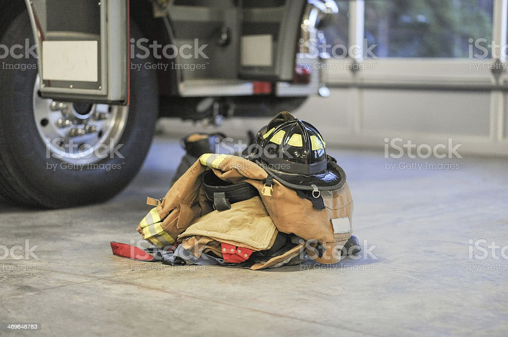Firefighter's protective gear on the station floor stock photo