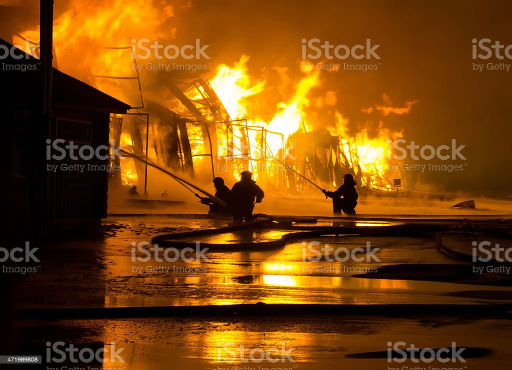 Firefighters putting out a large structure fire stock photo