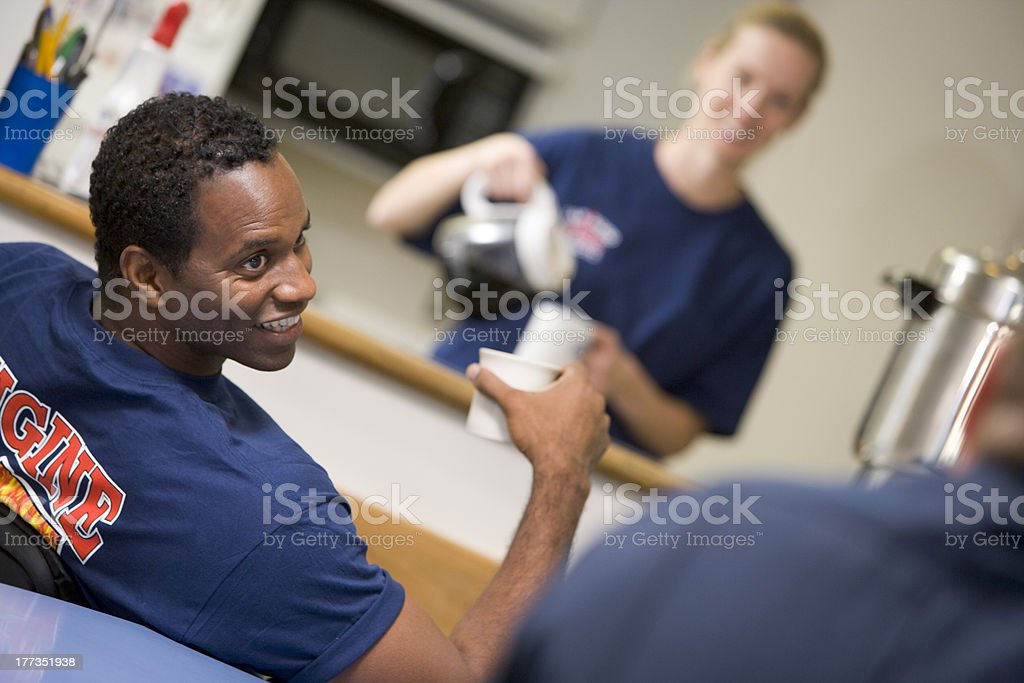 Firefighters relaxing in the staff kitchen stock photo