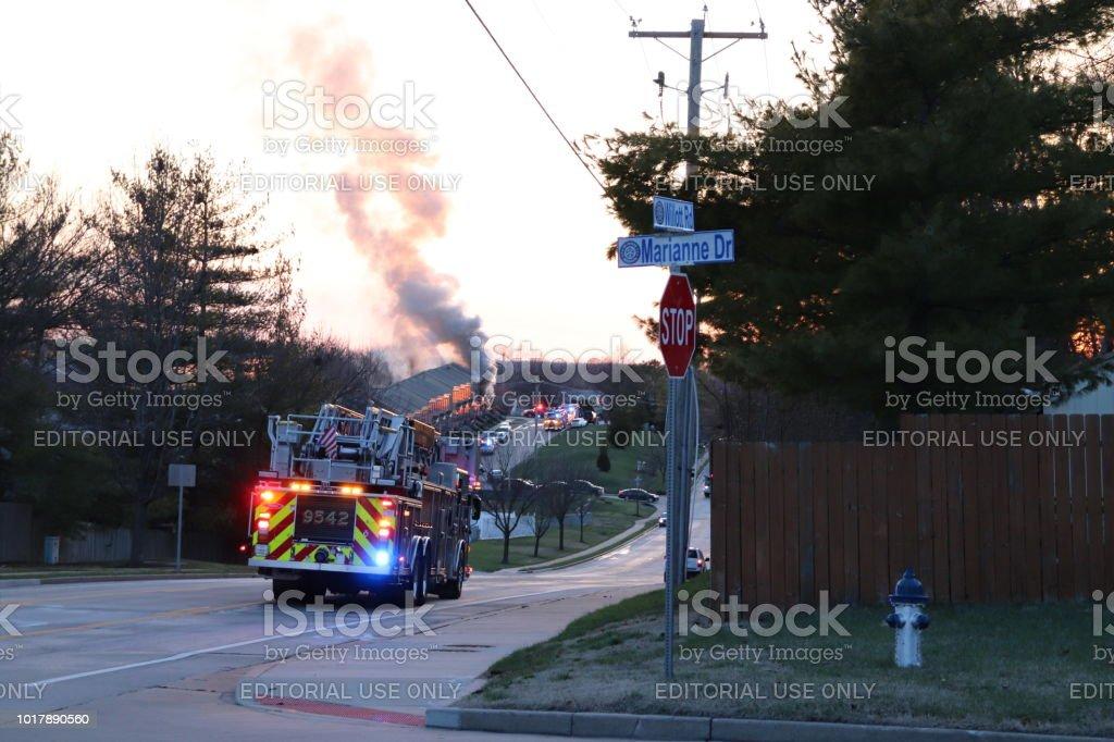 Firefighters Rush To Condominium Fire stock photo