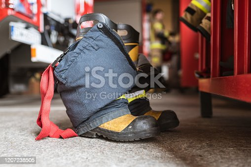 istock Firefighter's shoes and pants 1207238505