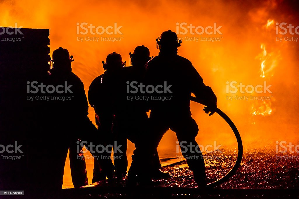 Firefighters silhouette stock photo