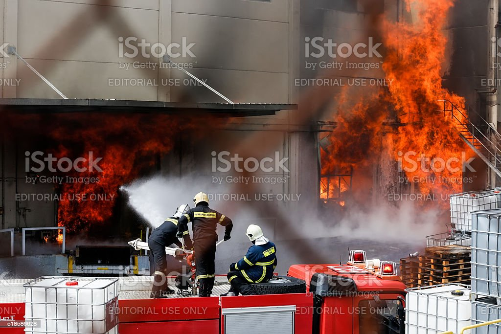 Firefighters struggle to extinguish the fire that broke stock photo