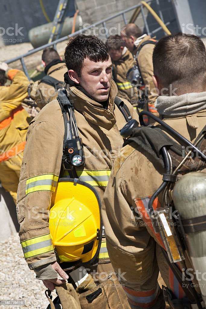 Firefighters Talking After Putting Out Fire in Building royalty-free stock photo