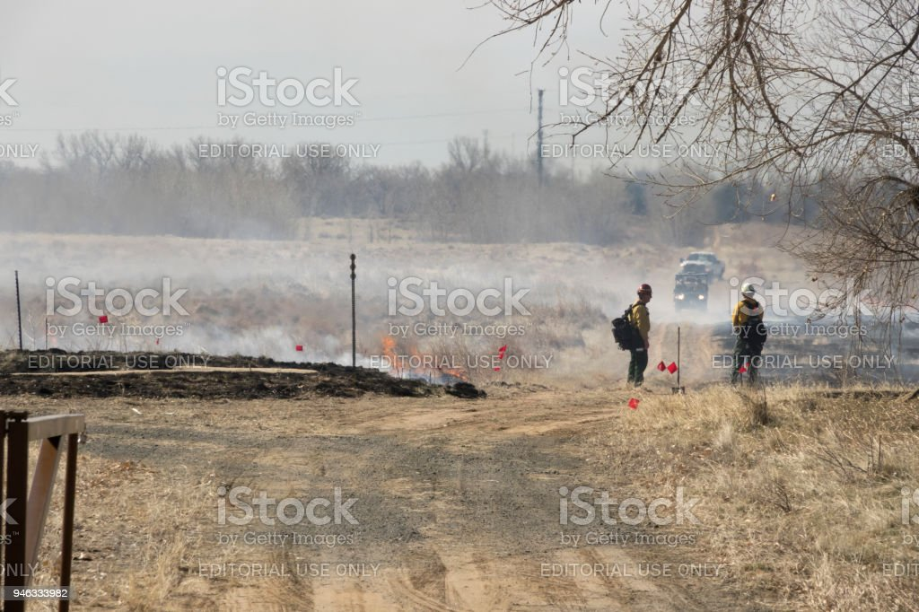 Firefighters watch controlled fire burn Rocky Mountain Arsenal National Wildlife Refuge Commerce City Colorado stock photo
