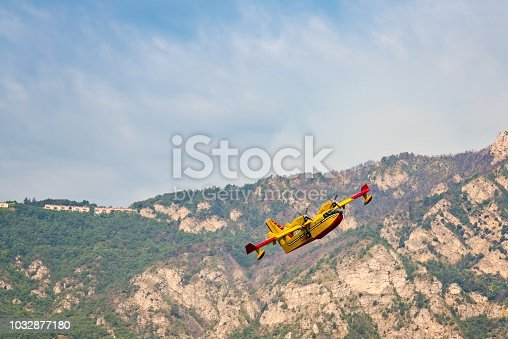 Firefighters water bomber aircraft in action in Italian mountains