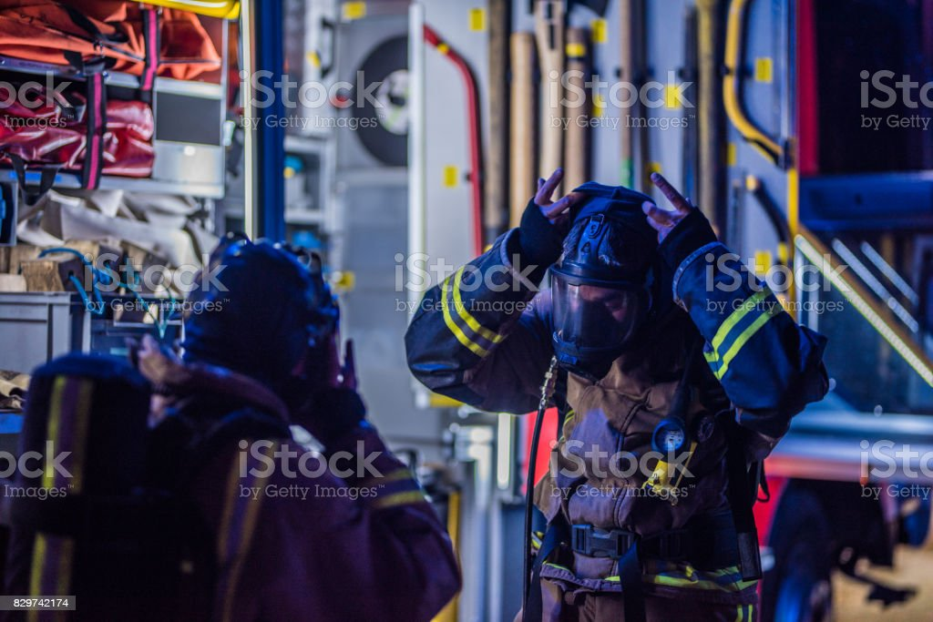 Firefighters working stock photo