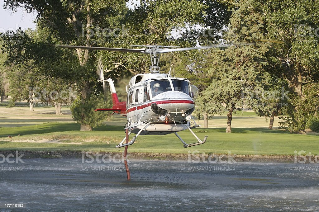 Firefighting Helicopter Refils Water Tank royalty-free stock photo