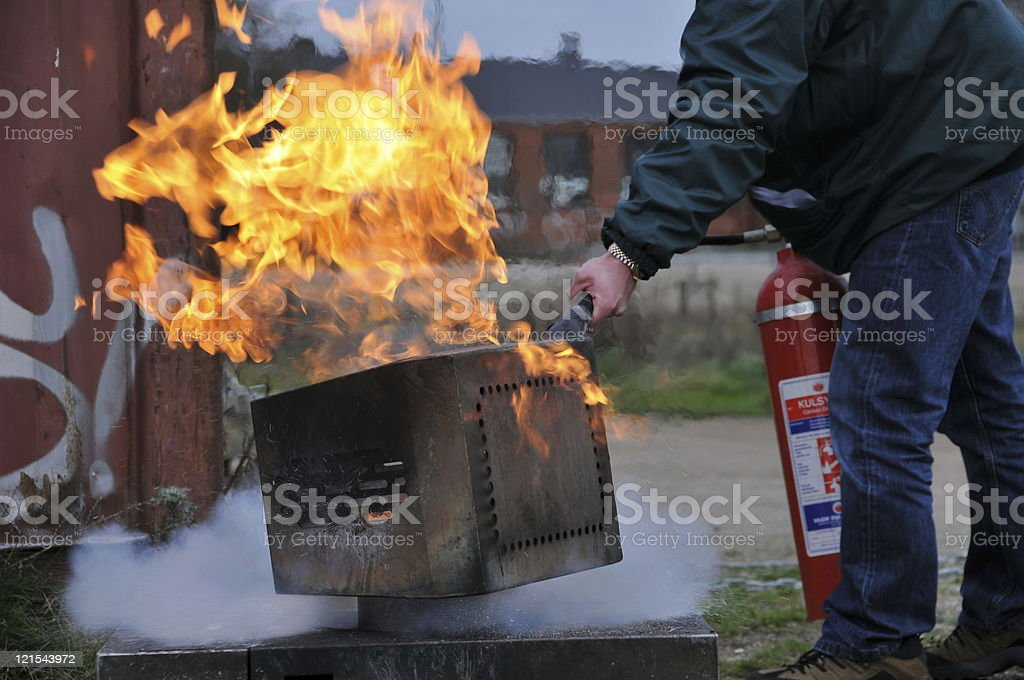 Firefighting with an extinguisher outside stock photo