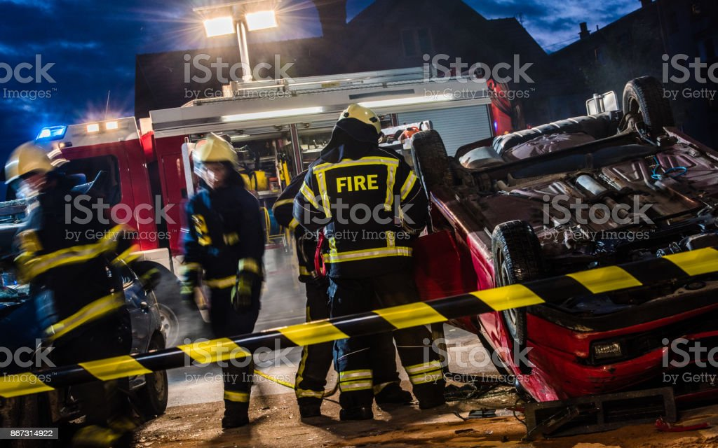 Firefigters At A Car Accident Scene stock photo 867314922 | iStock