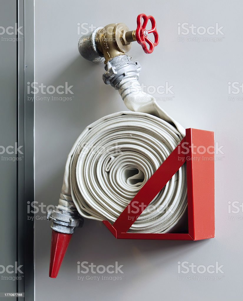 Fire-hose on the wall stock photo