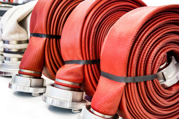 Firehoses Close up of rolled-up fire hoses fire hydrant stock pictures, royalty-free photos & images