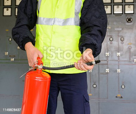 Man showing and demonstrates how to use fire extinguisher