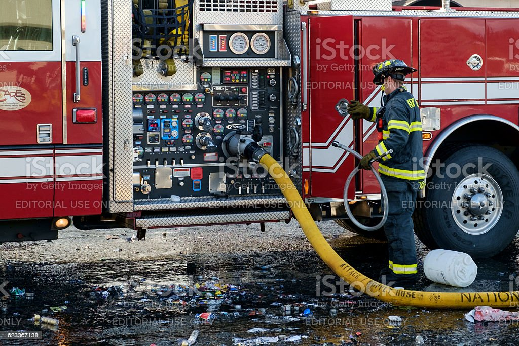 Fireman at fire engine stock photo