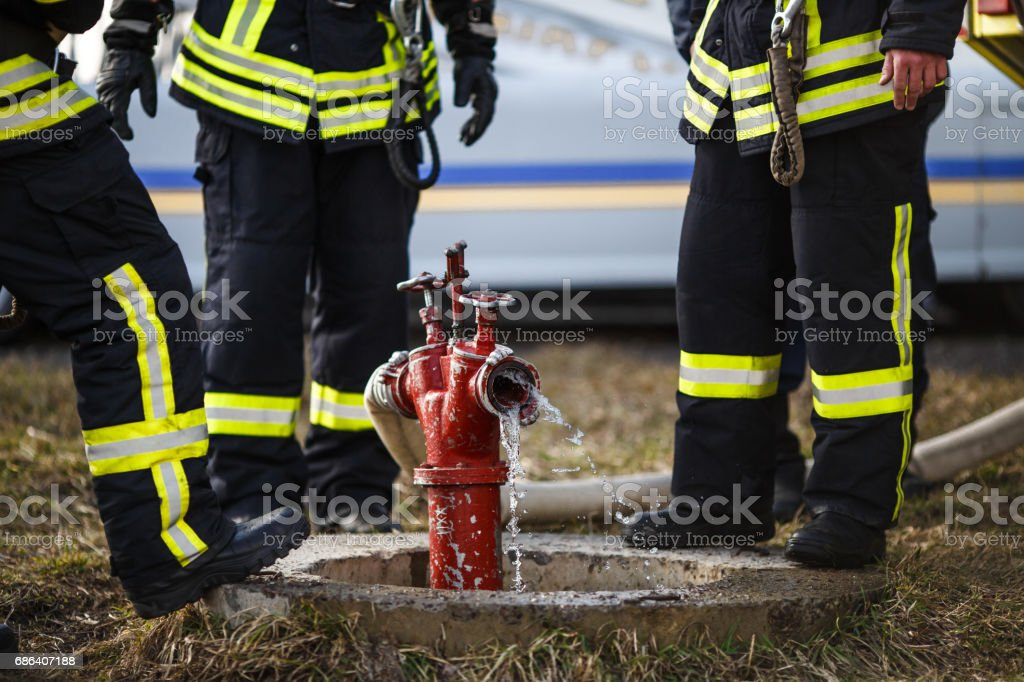 fireman drills, water spill combustion zone stock photo