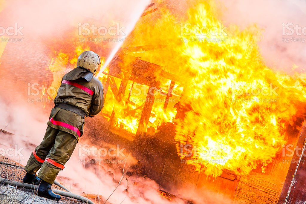 Fireman extinguishes a fire stock photo