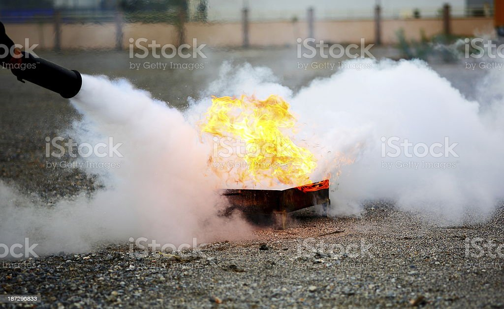 A fireman extinguishing a fire stock photo