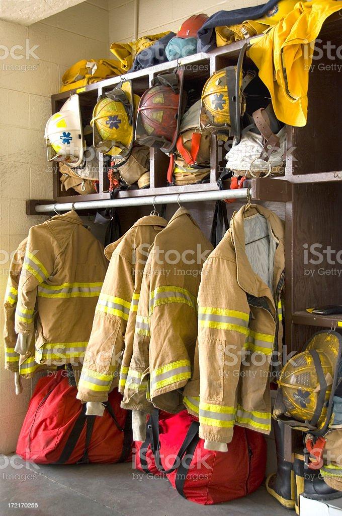 Fireman Gear in a Fire Station Locker stock photo