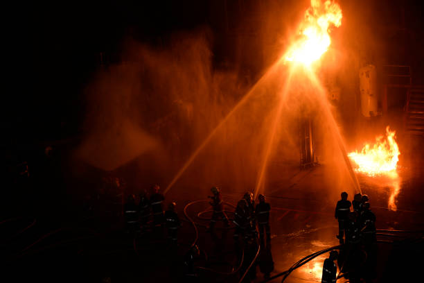 Fireman in firefighting at night. stock photo
