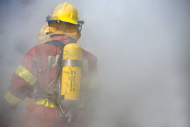 fireman in operation surround with smoke – Foto