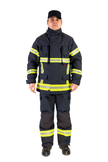 Fireman in uniform isolated in white Fireman in uniform isolated in whiteFireman in uniform isolated in white smoke jumper stock pictures, royalty-free photos & images