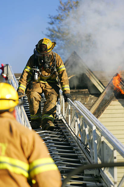 Fireman on ladder stock photo