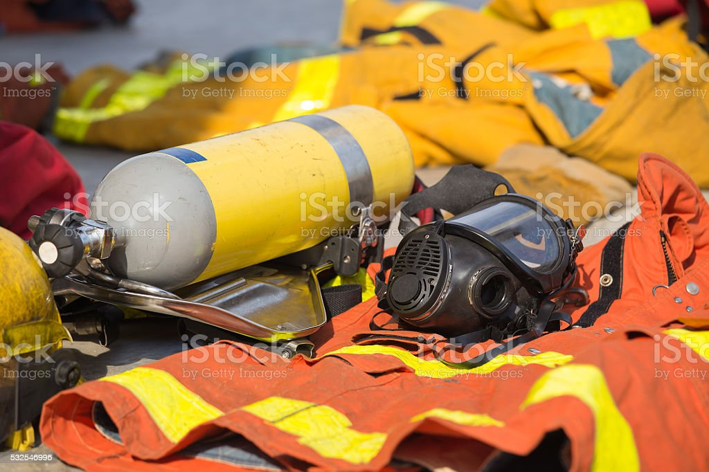 fireman oxygen mask and air tank with equipment stock photo
