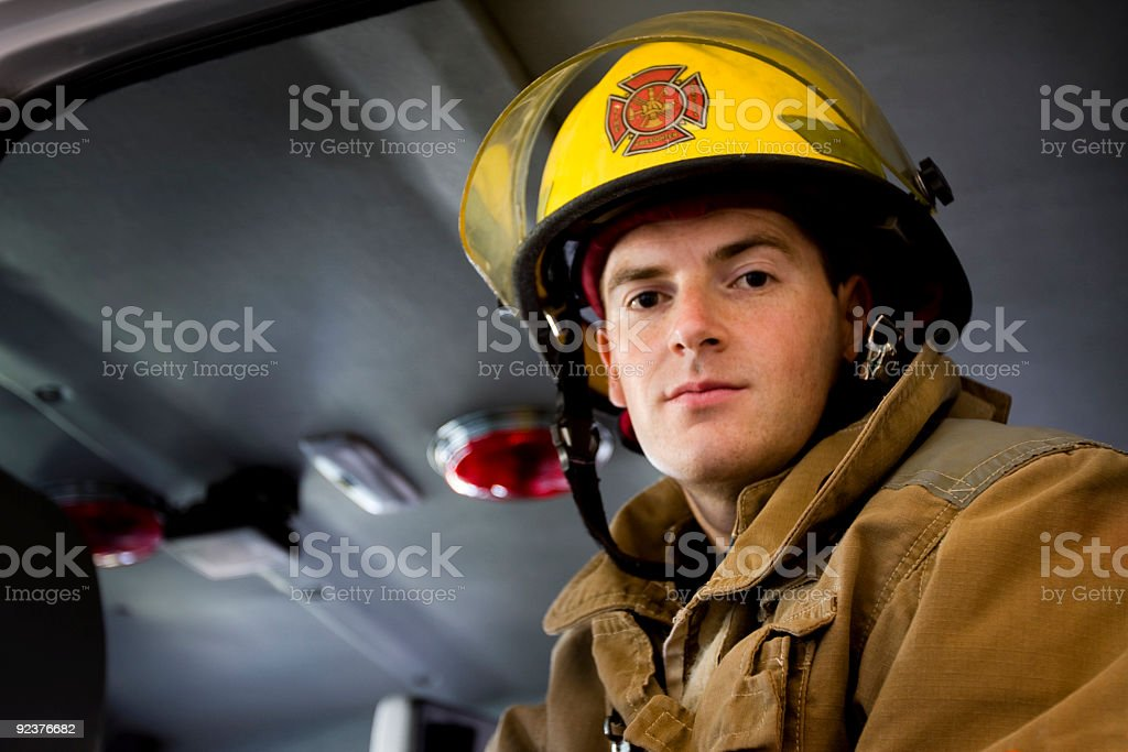 Fireman ready for action stock photo