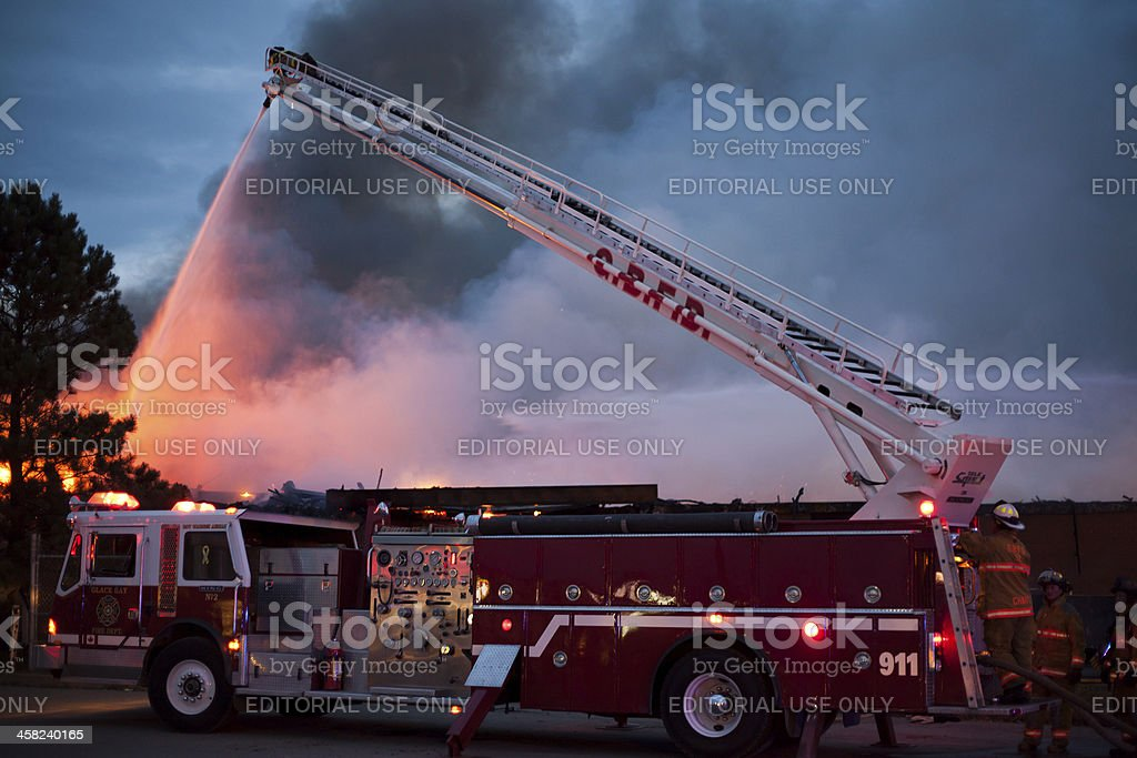 Fireman Sprays Fire From Above royalty-free stock photo