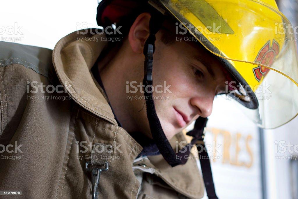 Fireman thinking royalty-free stock photo