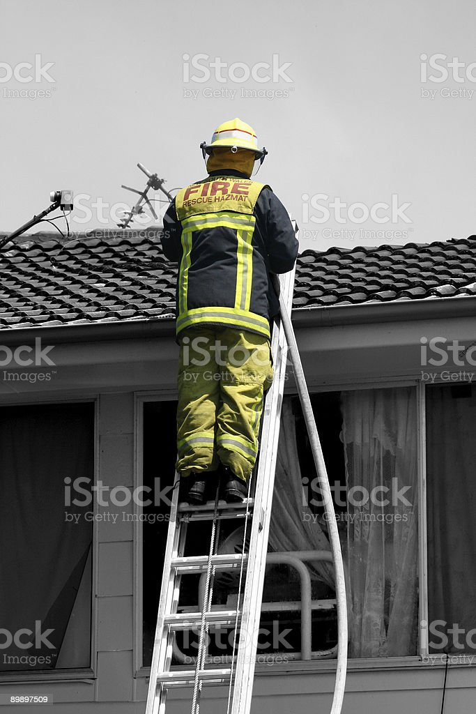 Fireman'una scala foto stock royalty-free