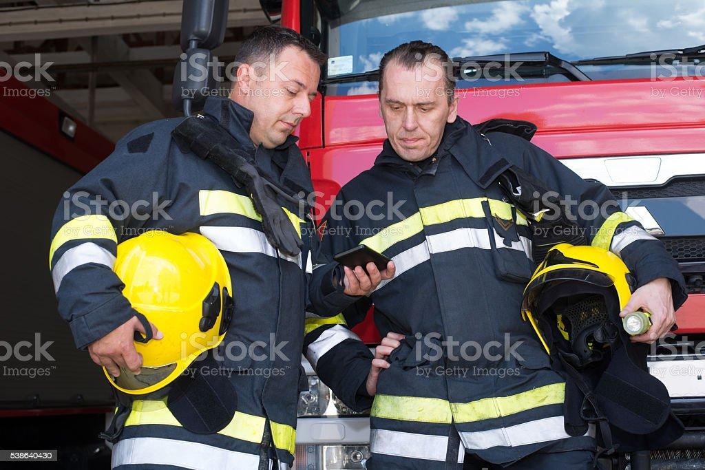 Firemans on duty stock photo