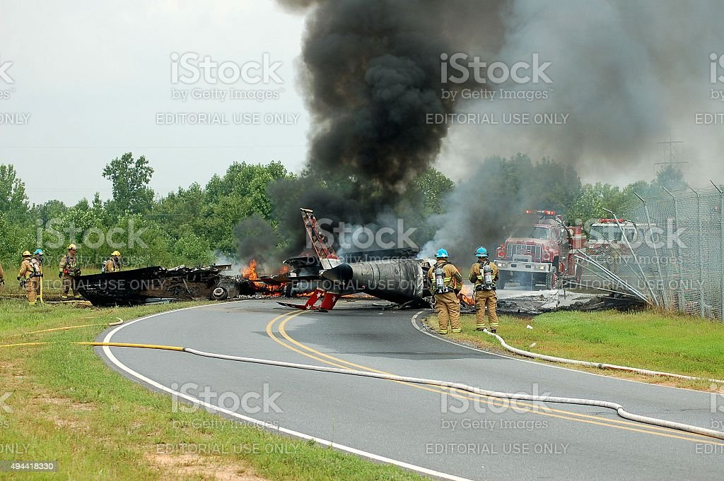 Firemen approaching F-86 plane crash at Hickory, NC airport stock photo
