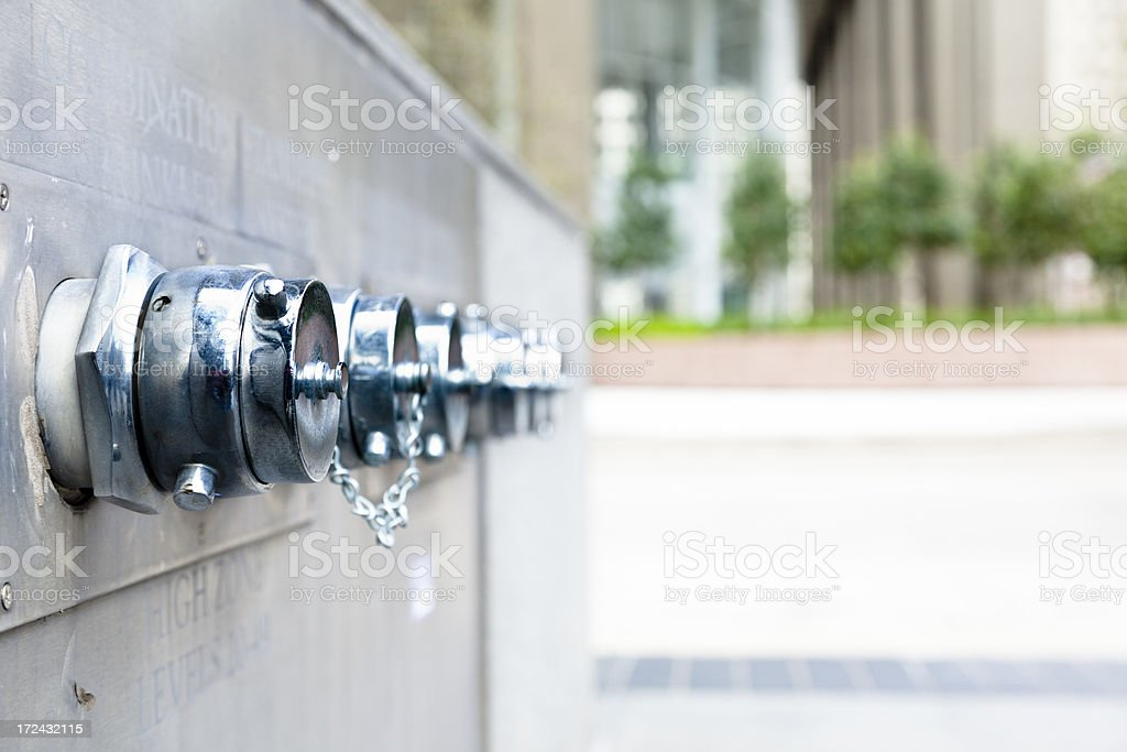 Firemen Department:  Multiple fire hydrant connections in downtown city. royalty-free stock photo