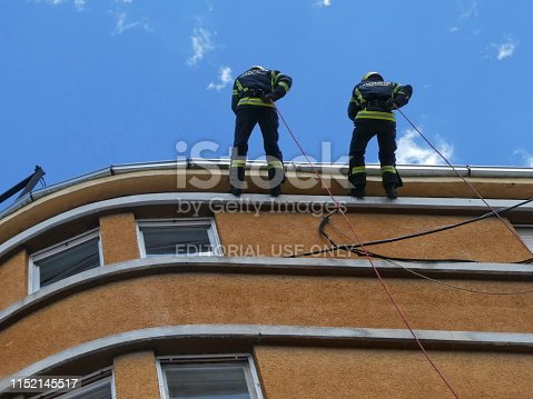 istock Firemen going down a rope from the roof - demonstration exercise 1152145517