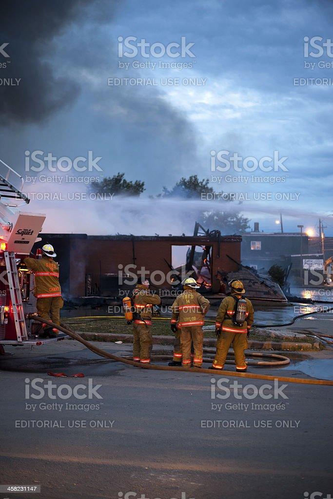 Firemen on Scene of McDonalds Building Fire royalty-free stock photo