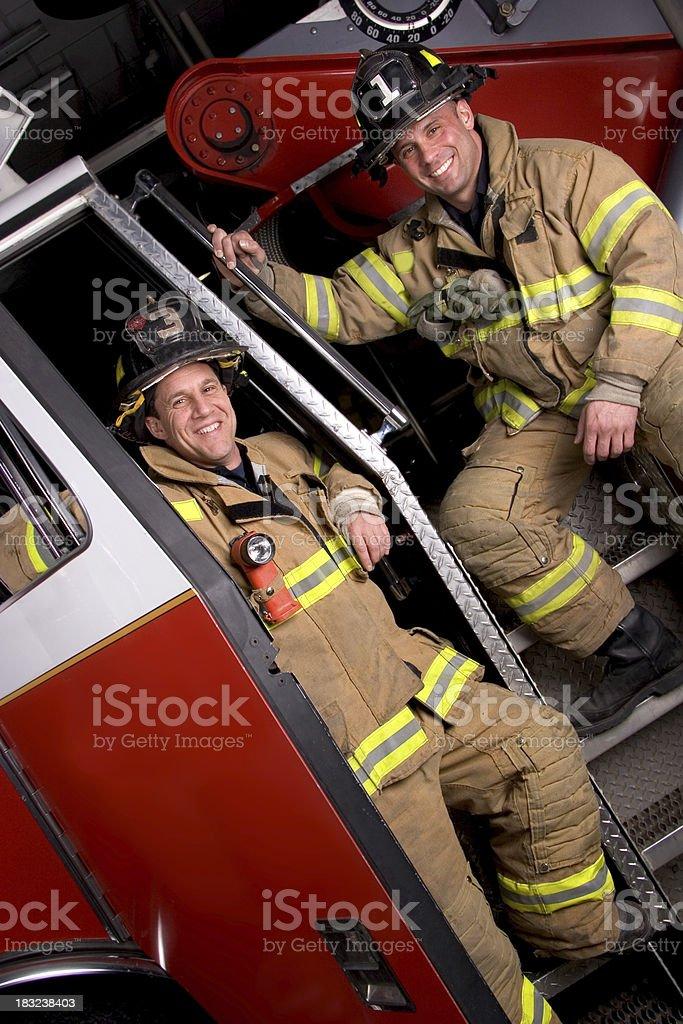 Firemen on Truck 2 royalty-free stock photo