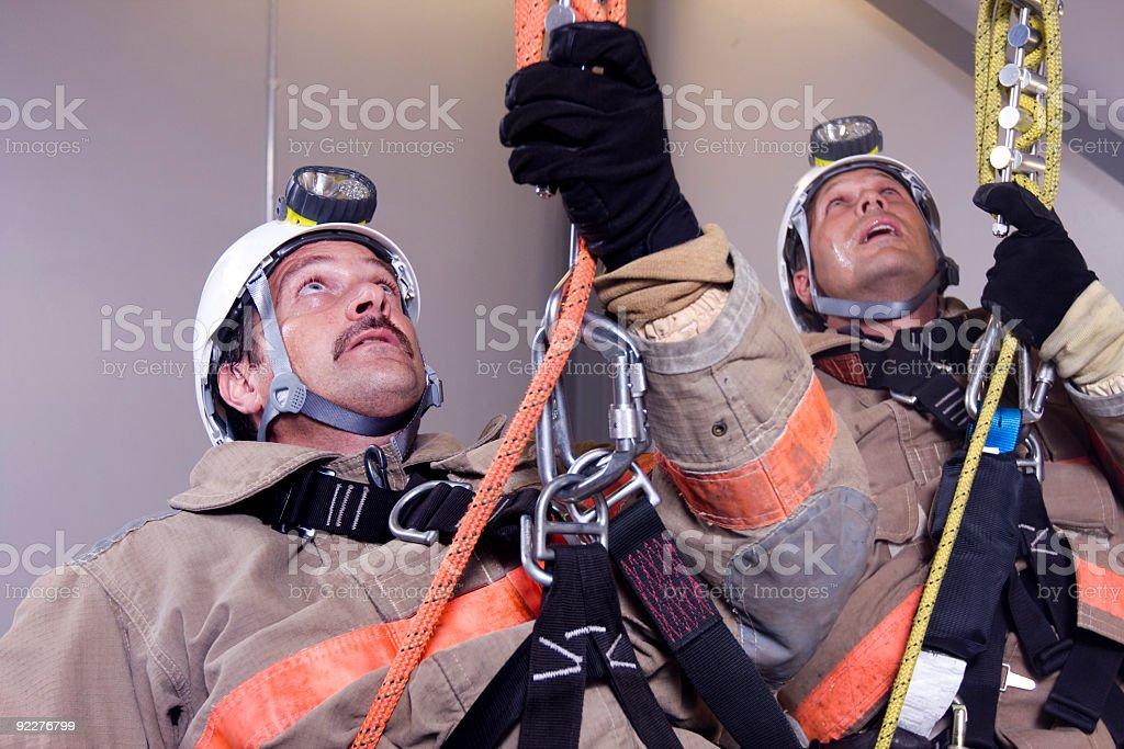 Firemen rescue stock photo