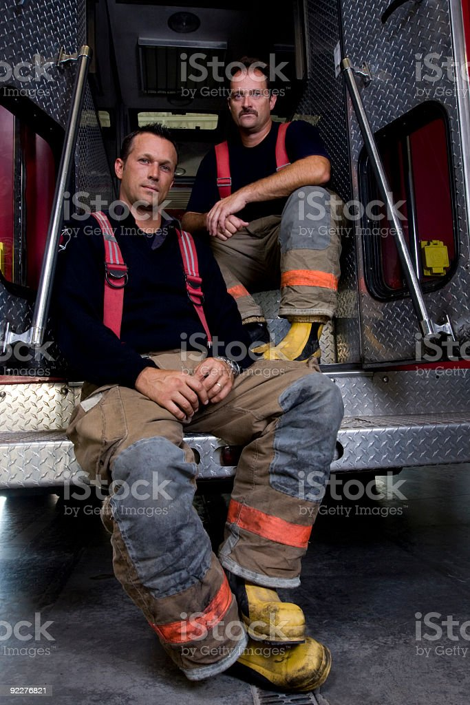 Firemen resting stock photo